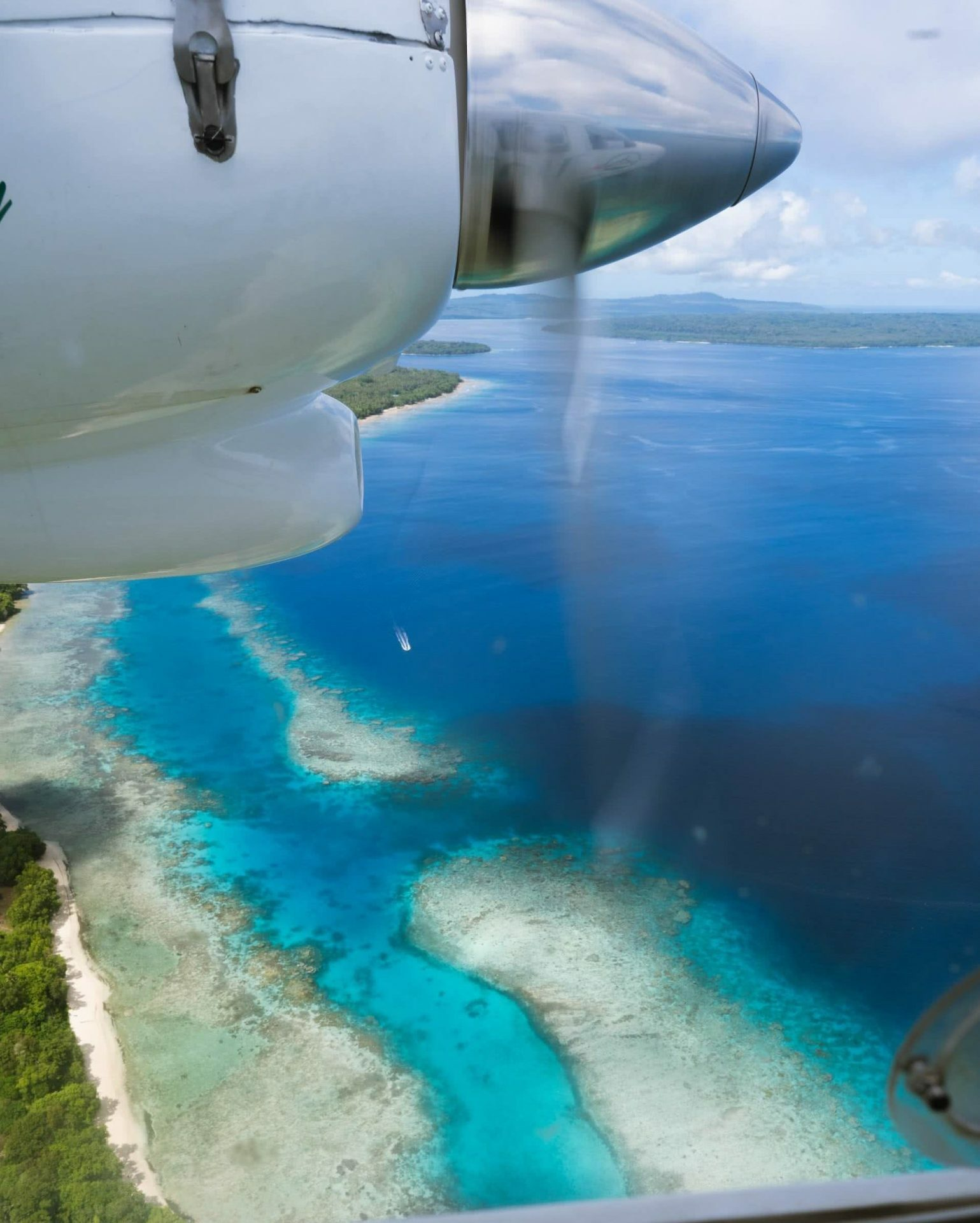 An Insider's Guide to Gaua, photos by Ben Savage and Ain Raadik, Ruby Claire, Vanuatu, island, plane view, window seat, ocean, reef, coastline