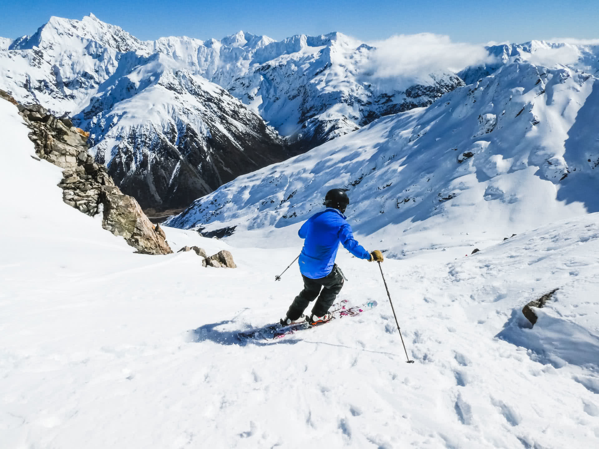 25 Laurence cracks on down toward Downhill Basin with Mt Rollaston in the distance. Temple Basin, 24 Incredible Ski Fields & Resorts in New Zealand, Huw Kingston, New Zealand, skiing, south island