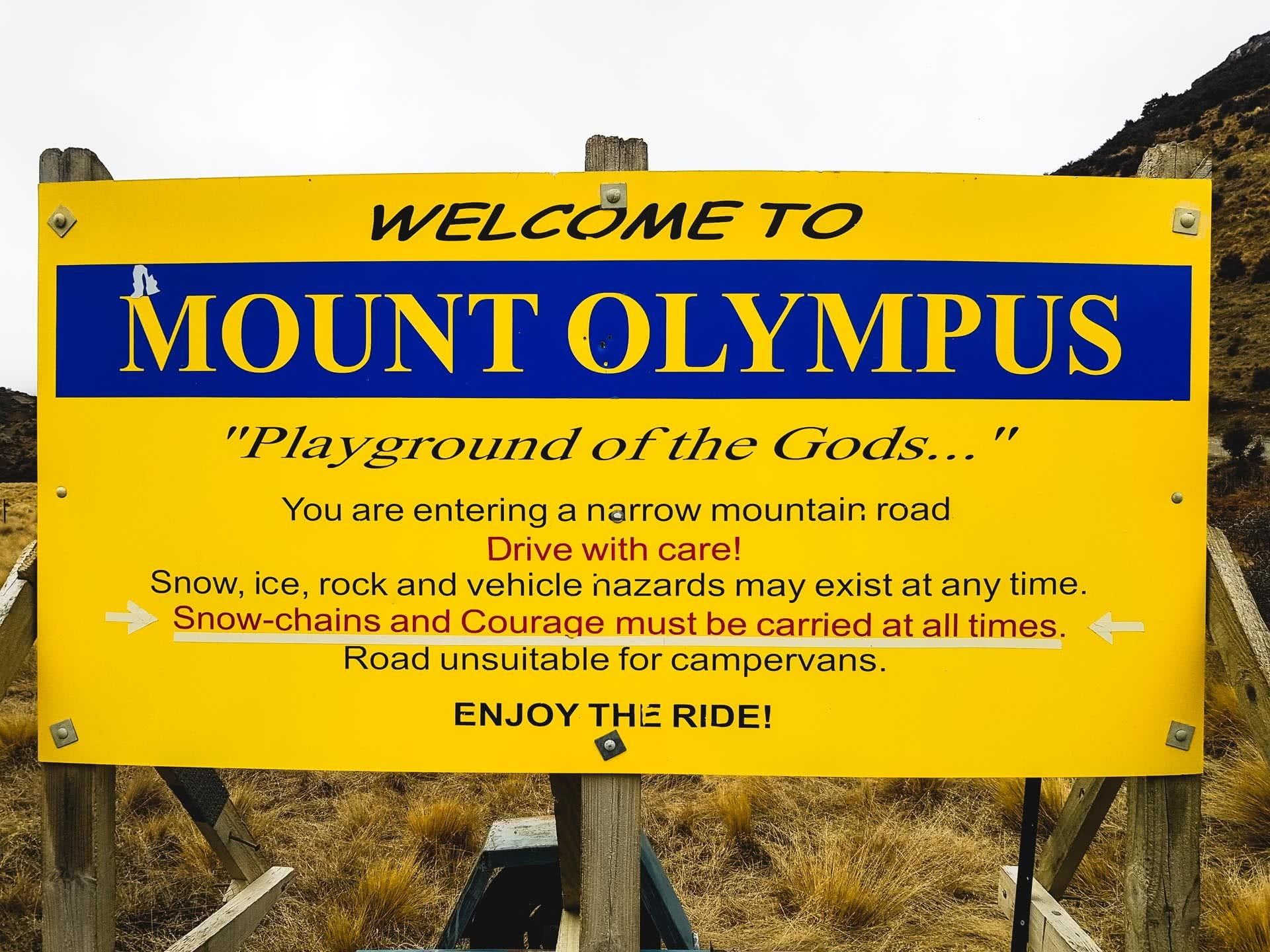30 Snow-chains _ Courage should be carried at all times. Road sign en route to Mount Olympus, 24 Incredible Ski Fields & Resorts in New Zealand, Huw Kingston, New Zealand