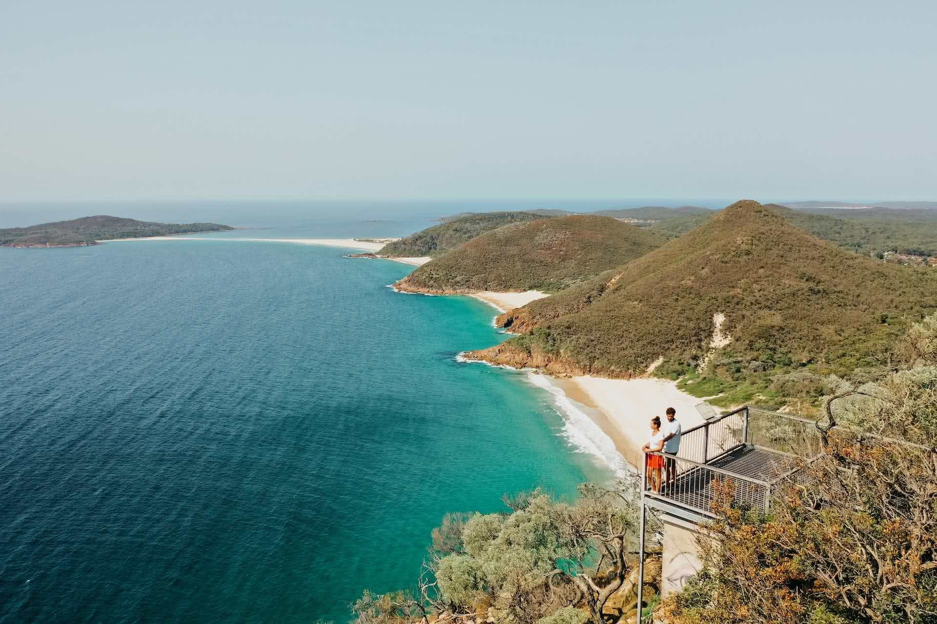 Plan Port Stephens for Your Next Adventure Weekender, photos by DNSW, Mt Tomaree, people, drone shot, lookout, ocean, beach, headlands