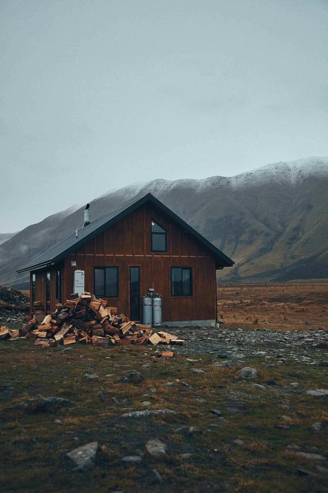 This High Country Cabin Offers the Wild Isolation We All Need Right Now, photo by Kenny Smith, cabin, isolation, twizel, south island, new zealand, firewood