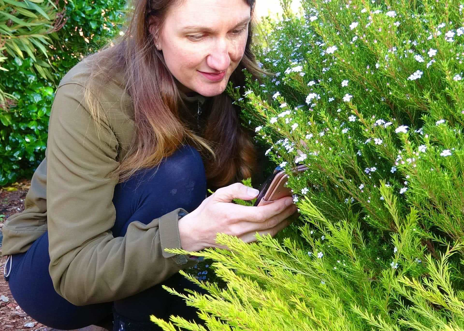 Expedition Anywhere: Explore The World With Citizen Science, Lynette Plenderleith, flowers, backyard, woman, phone