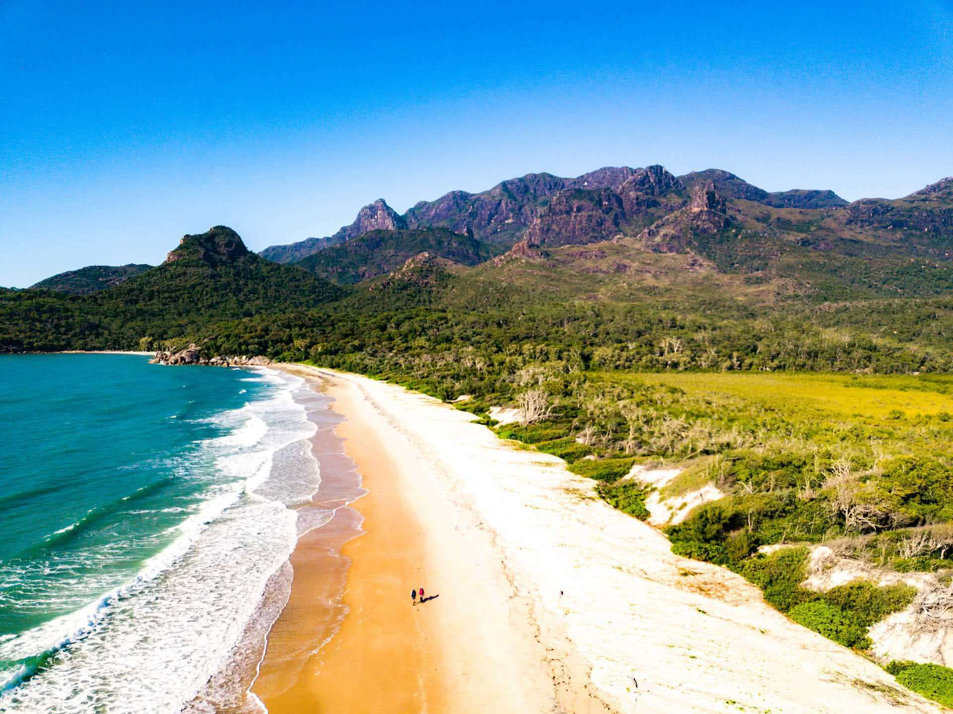 The Thorsborne Trails Offers 4 Days of Tropical Island Trekking, Andrew Boyle, Hinchinbrook Island, Ramsay Bay, mountains, beach, ocean, drone shot, hikers