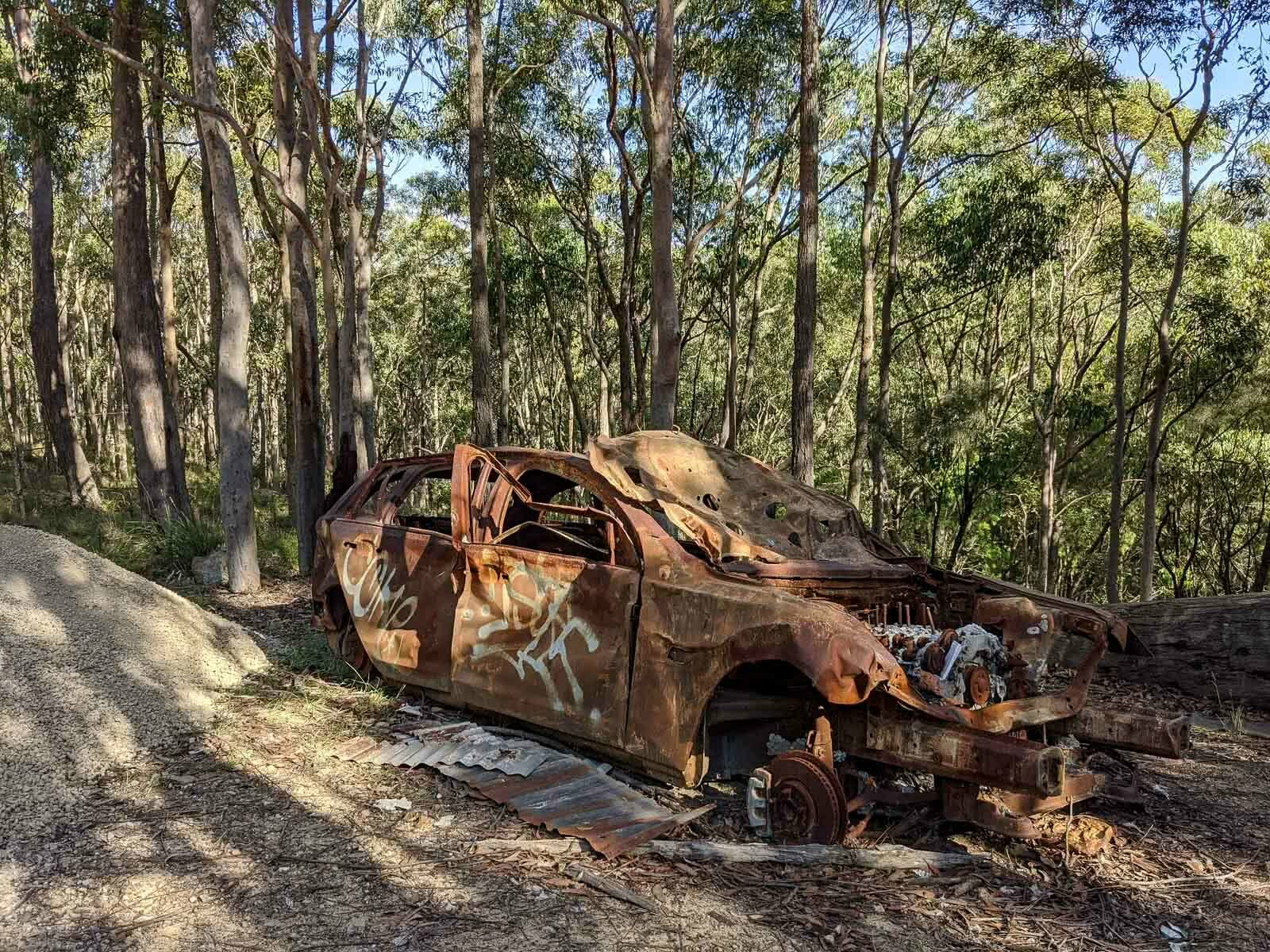 Hiking the Great North Walk – Sydney's 250km Thru Hike, jason reeves, sydney to newcastle, nsw, burnt out car