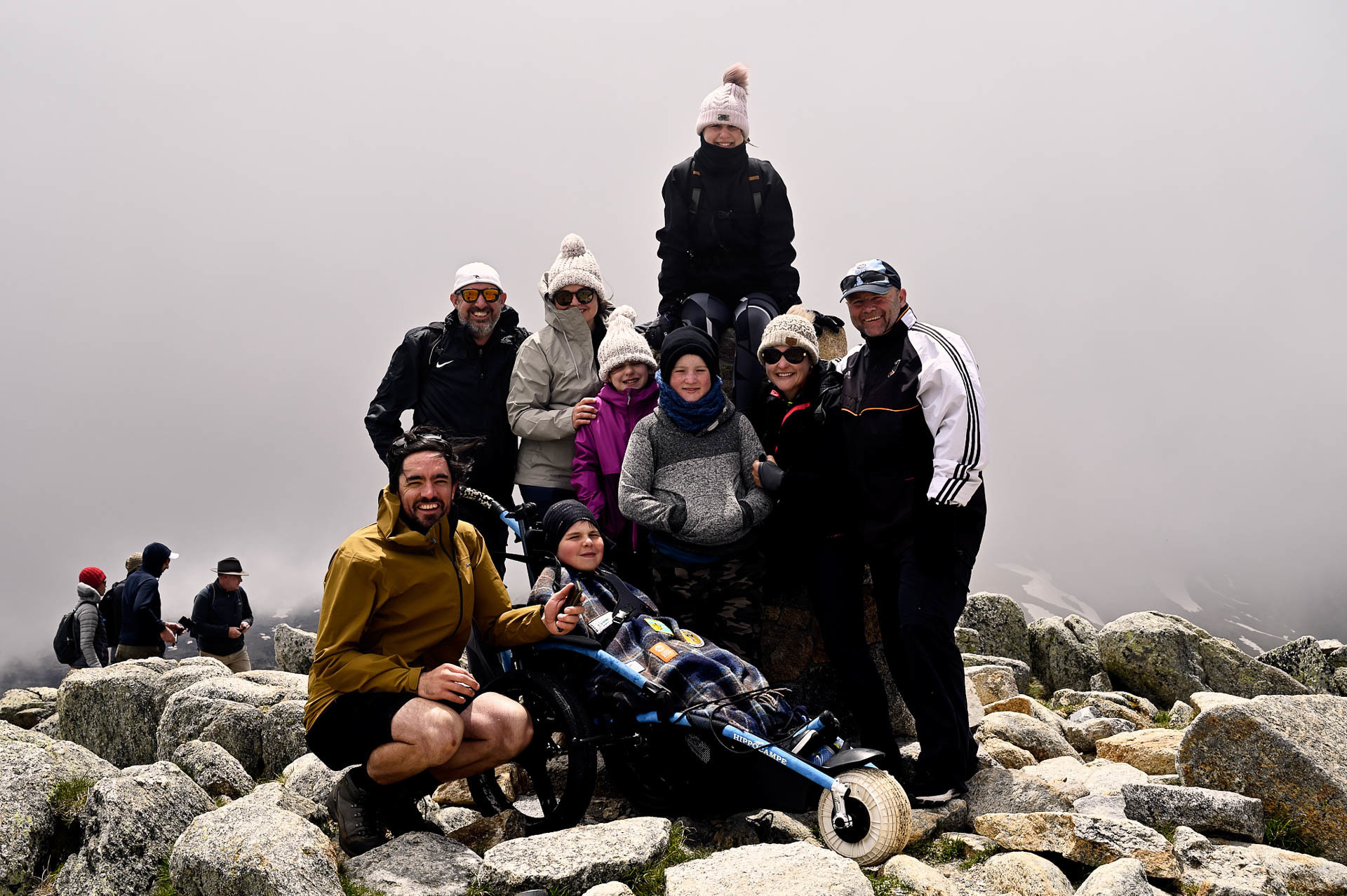 Group photos at the top of Australia, 4 Ideas for Accessible Adventures in NSW, joe kennedy, kosciuszko national park, summit track