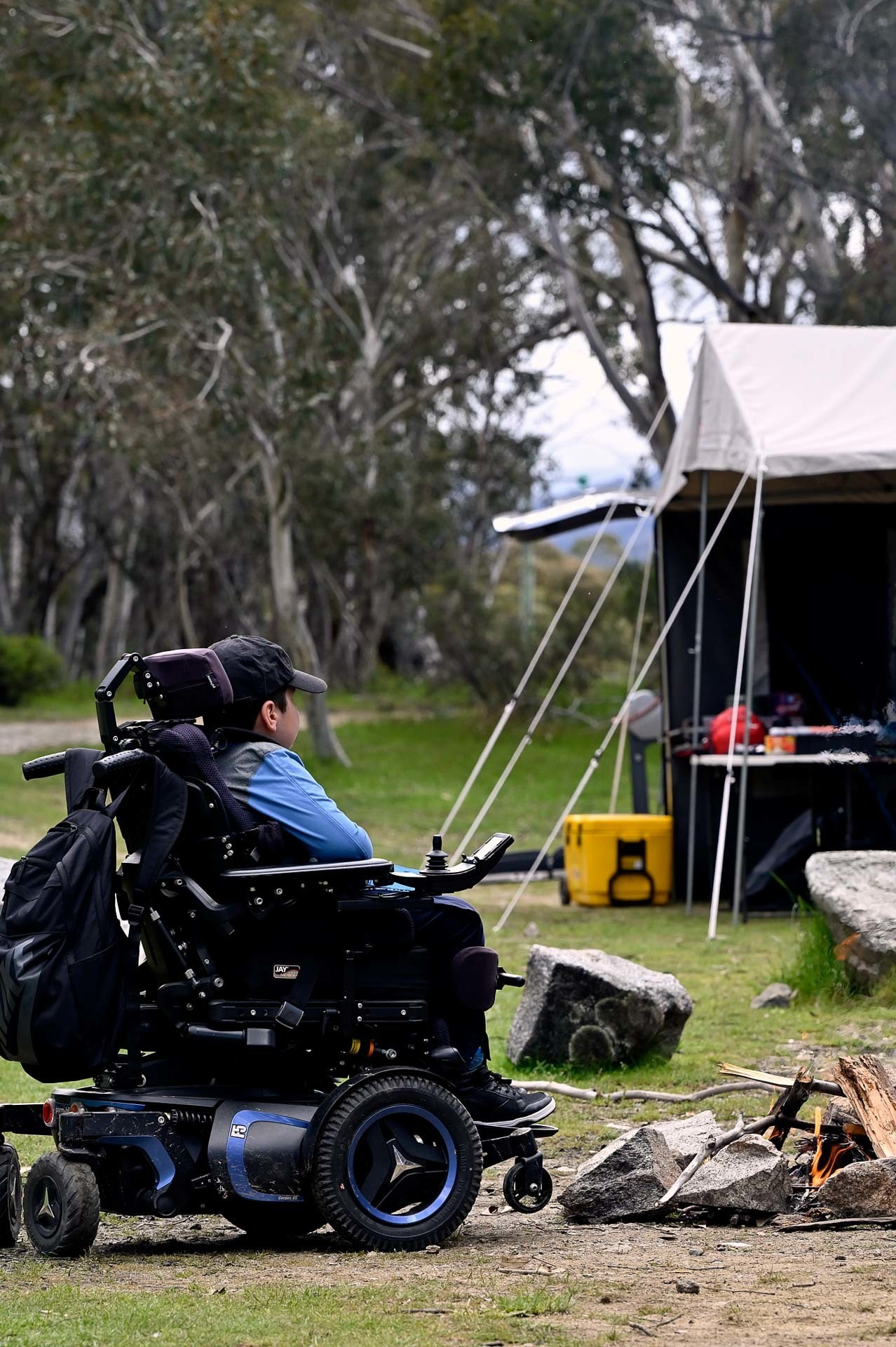 Josh chilling by the fire, 4 Ideas for Accessible Adventures in NSW, joe kennedy,a