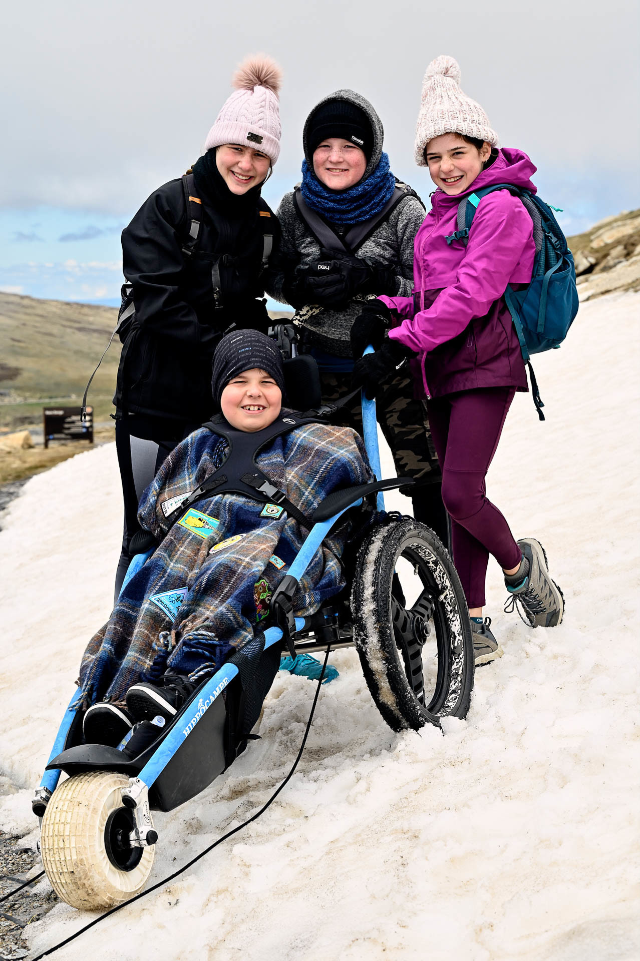 Josh, his sister and cousins the novelty of a play in the snow, 4 Ideas for Accessible Adventures in NSW, joe kennedy, kosciuszko national park, summit track