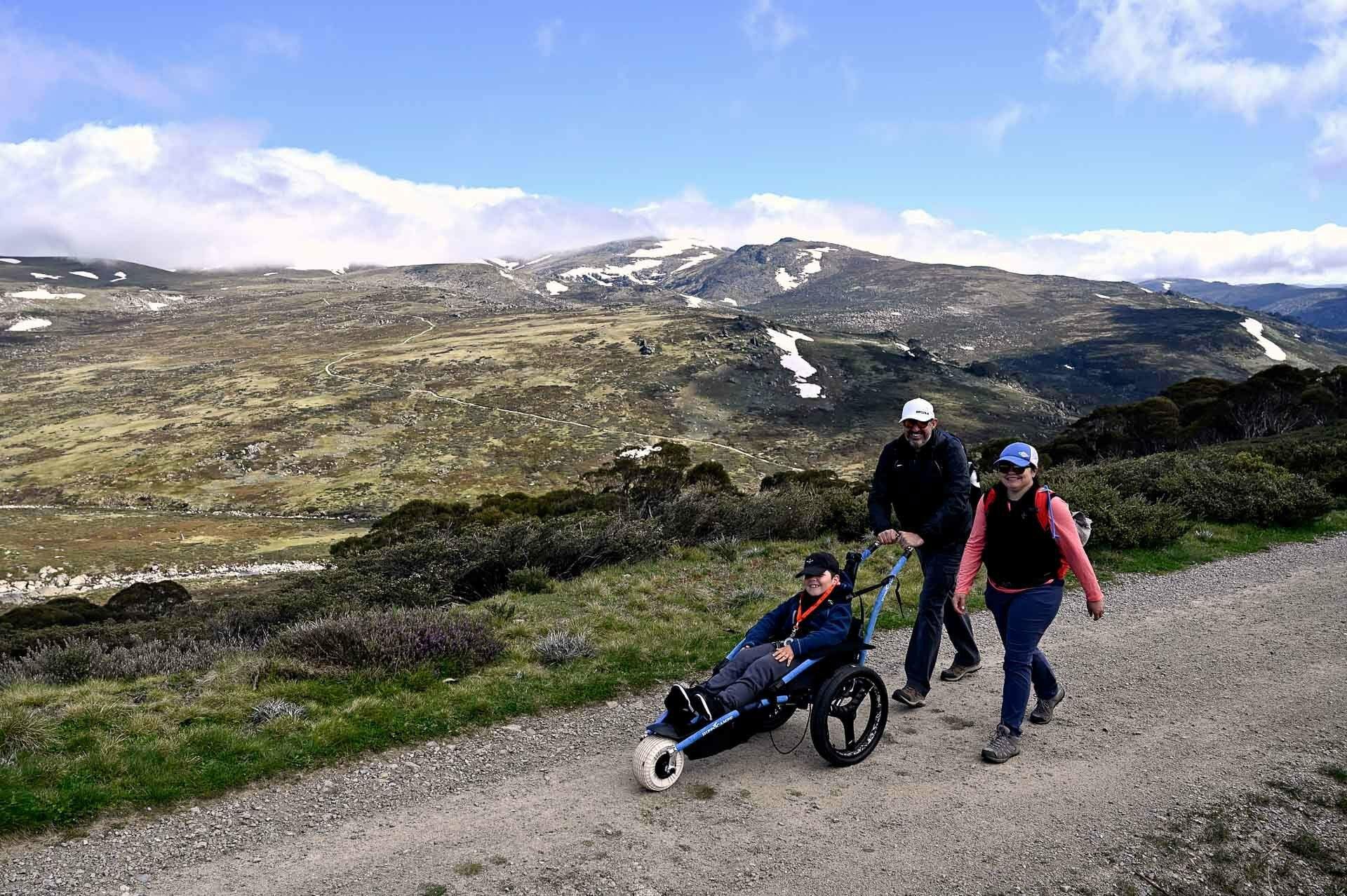 Josh on the trail with his mum and dad, 4 Ideas for Accessible Adventures in NSW, joe kennedy, kosciuszko national park, summit track