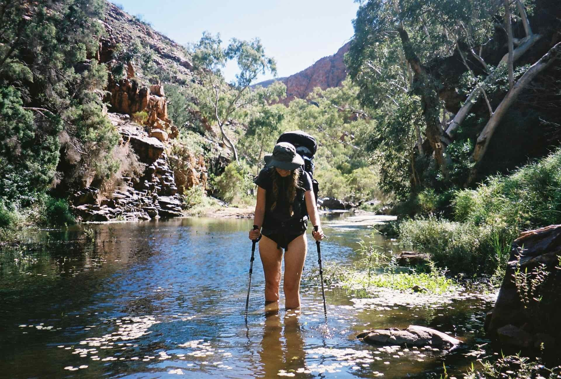 10 Things You Need to Know Before Hiking The Larapinta Trail, Ruby Claire, Central Australia, gorge, river, woman, hike, wade, hiking poles