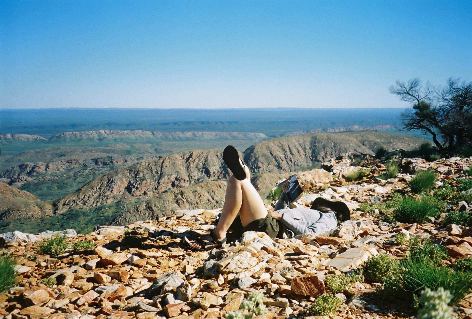 10 Things You Need to Know Before Hiking The Larapinta Trail, Ruby Claire, Central Australia, sleep, nap, read, rest, woman, tevas, read, mountains, desert