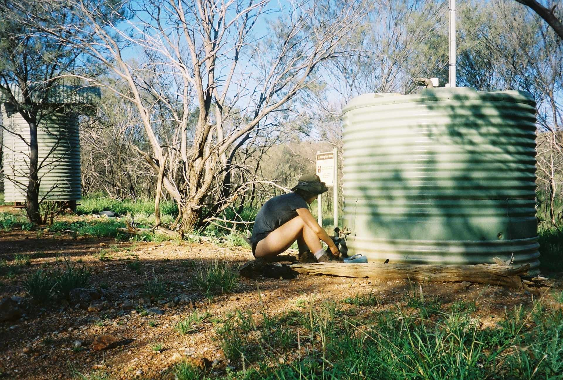 10 Things You Need to Know Before Hiking The Larapinta Trail, Ruby Claire, Central Australia, hike, woman, film, water tank