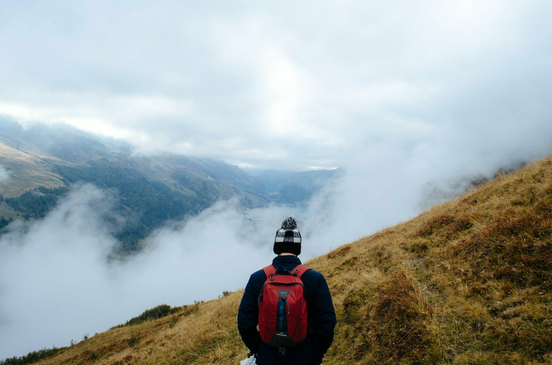 How To Read The Weather Like a Pro, photo by Naomi Hutchinson (unsplash), man, hike, mountains, clouds, fog